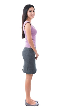 Full body side view Asian young woman standing on white background Stock Photo