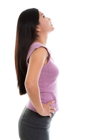business woman standing: Side view of beautiful Asian young woman looking up standing on white background