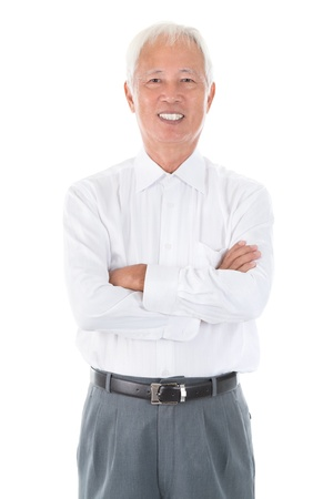 Confident arms crossed senior adult Asian Chinese businessman standing isolated white background photo