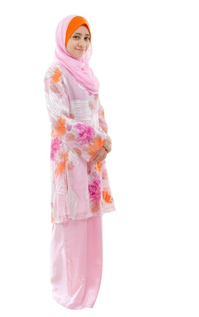 full length woman: Portrait of full body Southeast Asian Muslim girl smiling, standing on white background Stock Photo