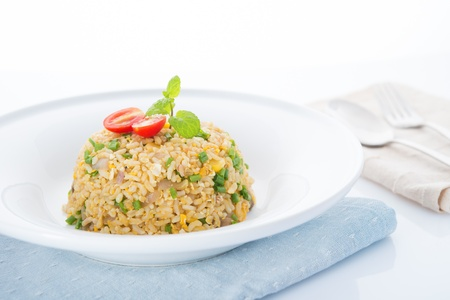 meatless: Chinese egg fried rice with spoon and fork on dining table Stock Photo