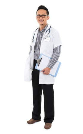Full body southeast Asian medical doctor. Male medical doctor holding a clipboard standing on white background with confident smile. photo