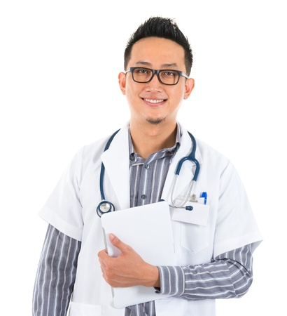 Southeast Asian medical doctor holding a tablet computer, smiling isolated white background Stock Photo
