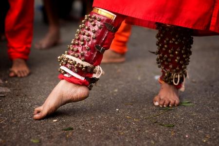 Close up of a devotees leg at Thaipusam event celebrating Lord Murugan, Batu Caves, Kuala Lumpur, Malaysia photo