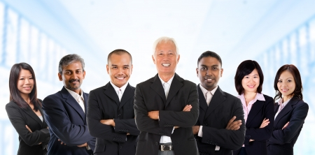 diversity people: Asian business team in multiracial. Diversity business people form by different races, Indian, Malay, Indonesian, Chinese standing in office environment. Stock Photo