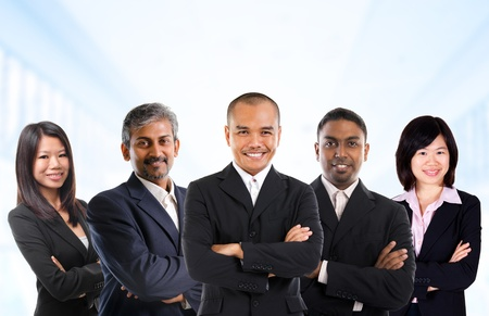 business environment: Asian business person in multiracial. Diversity business people form by different races, Indian, Malay, Indonesian, Chinese standing in office environment. Stock Photo