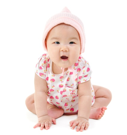 asian baby girl: Full body Six months old East Asian baby girl sitting on white background