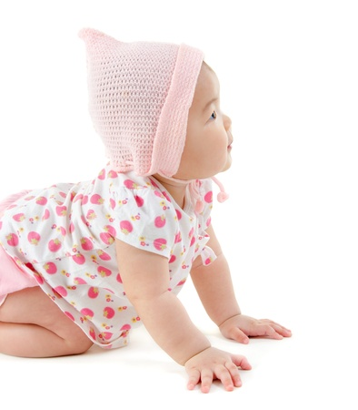 asian baby girl: Six months old East Asian baby girl crawling on white background Stock Photo