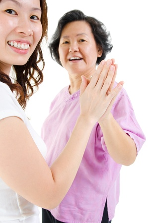 korean girl: Asian family. Asian senior parent hand to hand with adult daughter, isolated on white background.