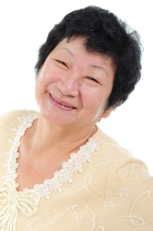 Happy 60s Asian Senior Woman on white background photo