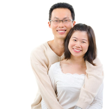 pan asian: Happy middle aged Asian couple in love. Asian couple smiling isolated on white background.