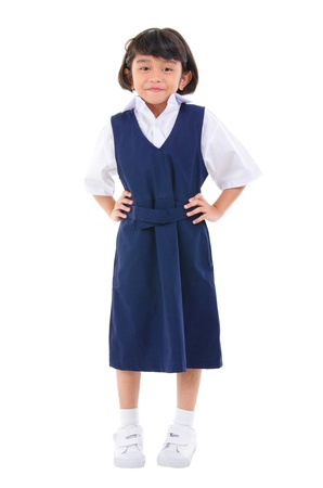 Seven years old Southeast Asian school girl in school uniform, fullbody over white background photo