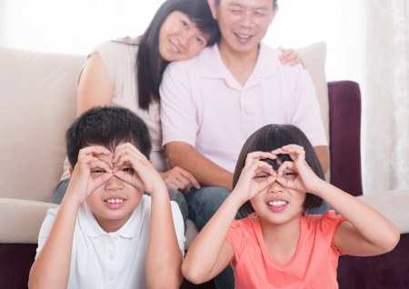 Southeast Asian family having fun at home photo