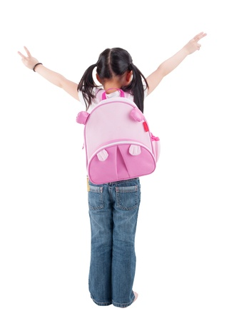 schoolbag: Full body rear view Asian child elementary student with schoolbag arms outstretched standing isolated on white background. Stock Photo
