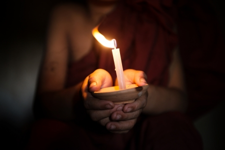 myanmar: Little monk holding a candlelight