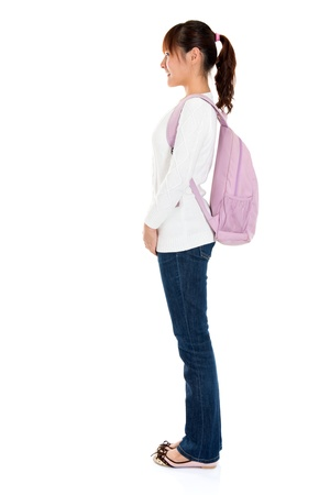 Full body side view of Asian female young adult student standing isolated on white background photo
