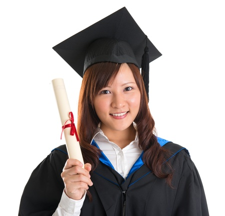 master degree: Portrait of happy Asian female student in graduate gown holding graduation diploma isolated on white background Stock Photo