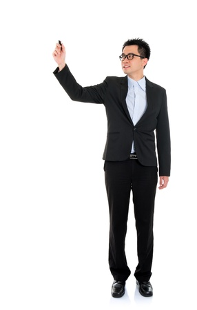 body writing: Full body picture of an Asian business man writing with marker standing isolated on white background Stock Photo