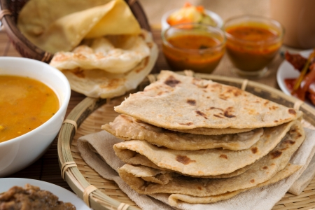 pakistani pakistan: Chapati or Flat bread, roti canai, Indian food, made from wheat flour dough. Roti canai and curry.
