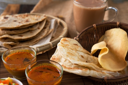 tarik: Roti canai, Chapati or Flat bread, teh tarik or milk tea and curry, famous Malaysian Indian food.