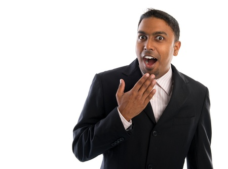surprising: Indian businessman surprise. Good looking Indian man in black suit showing surprising face, isolated on white background.