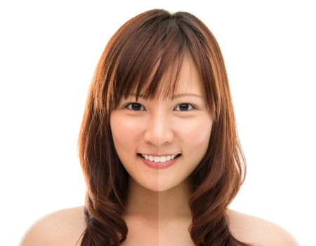 half: Asian woman face with half tan skin (before and after) isolated on white background. Beautiful Asian girl model. Stock Photo