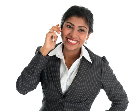 Indian woman talking on phone. Smart Indian business woman on the phone smiling happy isolated on white background. Beautiful Asian female model. Stock Photo - 20020607
