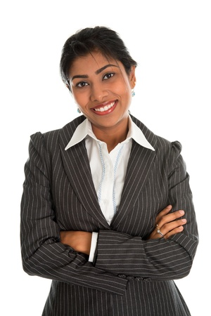 Confident Indian businesswoman arms crossed in business suit smiling, standing isolated on white background. Asian female model. photo