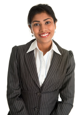 Indian businesswoman in business suit smiling looking at camera, standing isolated on white background. Asian female model.