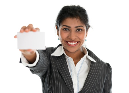 Indian businesswoman shows a blank business card for marketing, Asian woman smiling happy isolated on white. photo
