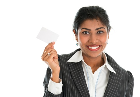 Indian businesswoman shows a blank name card for marketing, Asian woman smiling happy isolated on white. Stock Photo