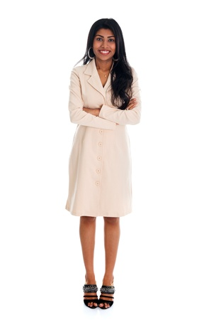 folded hands: Isolated confident Indian businesswoman smiling at the camera, full body standing against white background. Stock Photo
