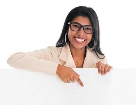 india woman: Indian woman holding and pointing to blank billboard. Portrait of attractive young Asian female model isolated on white background.