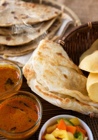 indian meal: Indian meal, Chapati flatbread, roti canai, dal, curry, teh tarik or pulled tea, acar. Famous indian food. Stock Photo