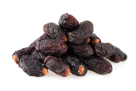 Dates fruit. Pile of dried date fruits isolated on white background.