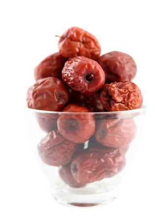 jujube fruits: Dried red date or Chinese jujube. Traditional herbal medicine isolated on white background.
