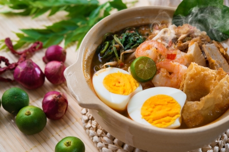 malaysian food: Prawn mee, prawn noodles. Famous Malaysian food spicy har mee fresh cooked in clay pot with hot steam. Stock Photo