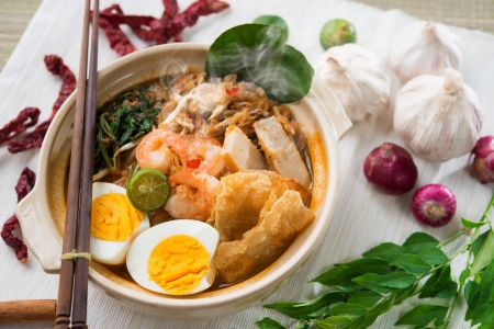yolk: Prawn mee, prawn noodles. Famous Malaysian food spicy fresh cooked har mee in clay pot with hot steam, serve with chopsticks.