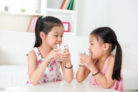 sister: Children drinking milk Stock Photo