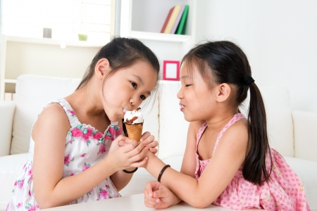 licking: Asian girls sharing an ice cream