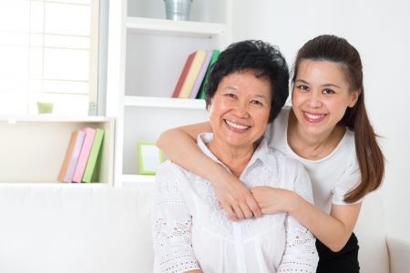 Happy Asian family senior mother and adult offspring having fun time at home. Stock Photo