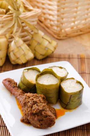 Lemak Lemang, traditional Malaysian food made of glutinous rice, coconut milk and salt. Cooked in a hollowed bamboo stick lined with banana leaves. Served during ramadan festival or hari raya. photo
