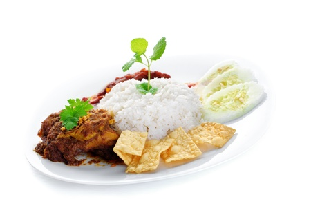 Nasi lemak traditional malaysia spicy rice dish. Served with belacan, ikan bilis, acar, peanuts and cucumber. Malaysian food. Asian cuisine.