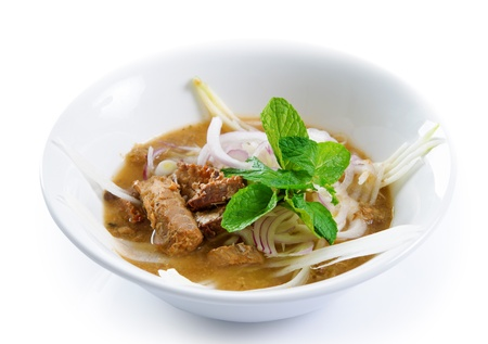 laksa: Assam or asam laksa  is a sour, fish-based soup. Delicious traditional Malay dish, malaysian food, Asian cuisine. Stock Photo