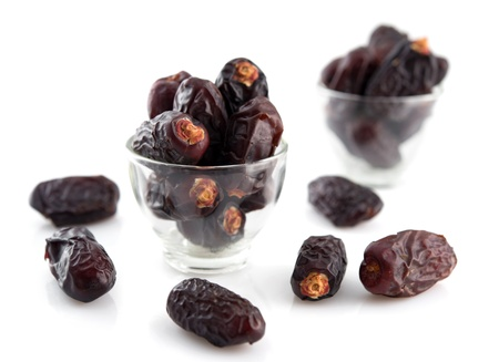 ramadhan: Dried date palm fruits or kurma, ramadan food which eaten in fasting month, isolated on white background. Stock Photo