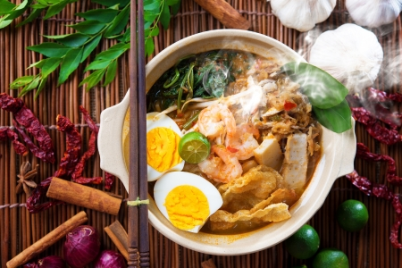 malaysian people: Prawn mee, prawn noodles. Popular Malaysian food spicy fresh cooked har mee in clay pot with hot steam. Asian cuisine. Stock Photo