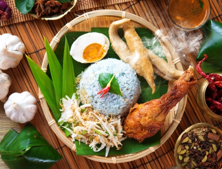 resulting: Nasi kerabu is a type of nasi ulam, popular Malay rice dish. Blue color of rice resulting from the petals of  butterfly-pea flowers. Traditional Malaysian food, Asian cuisine.
