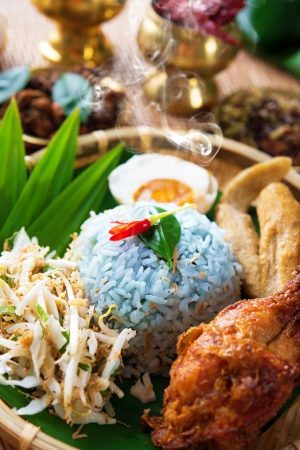 malaya: Traditional Malaysian food. Nasi kerabu is a type of nasi ulam, popular Malay rice dish. Blue color of rice resulting from the petals of  butterfly-pea flowers. Asian cuisine.
