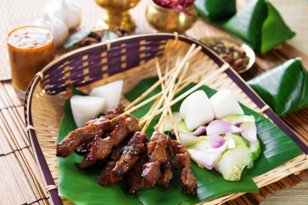 satay sauce: Beef satay, roasted meat skewer Malay food. Traditional Indonesia food. Hot and spicy Indonesian dish, Asian cuisine.