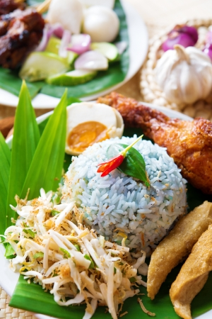 keropok: Nasi kerabu or nasi ulam, popular Malaysian Malay rice dish. Traditional east coast blue rice. Famous in states such as Terengganu or Kelantan . Malaysia food, Asian cuisine.